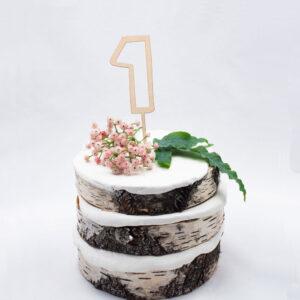 Rento vanerinen kakkukoriste jossa numero yksi.